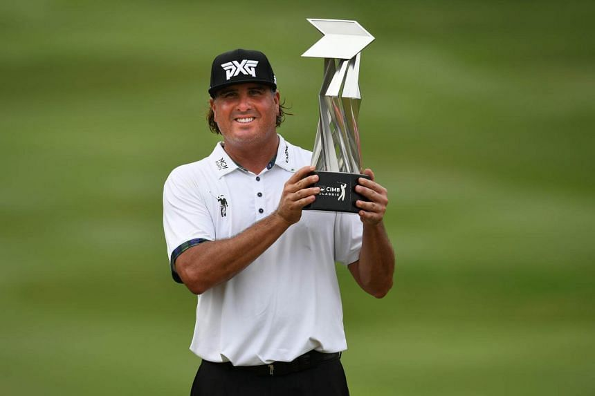 Pat Perez of the USA poses with the trophy after winning the 2017 CIMB Classic Golf PGA Tour tournament in Kuala Lumpur, Malaysia, on oct 15, 2017.