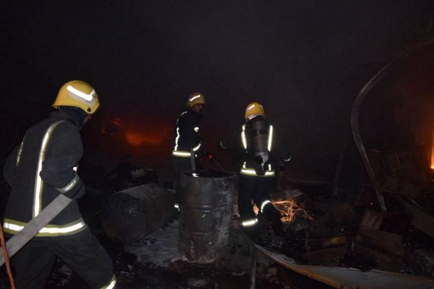 The civil defence posted photos of what appeared to be an enormous lumber yard engulfed in flames, with firefighters working through the night to douse the blaze.