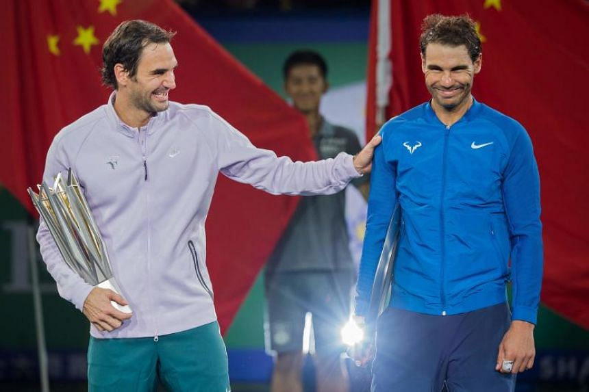 World No. 2 Roger Federer and world No. 1 Rafa Nadal celebrating with their respective Shanghai Masters winner and runner-up trophies respectively.