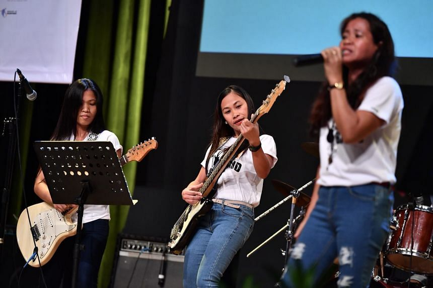 The new Foreign Domestic Worker Association for Social Support and Training (Fast) All-FDW band performs during the 8th Foreign Domestic Worker Day.