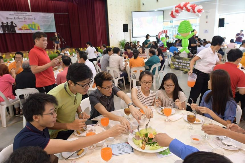 NSmen and their families tuck into local produce from Sembawang community gardeners at an appreciation luncheon at Woodlands Galaxy Community Club.