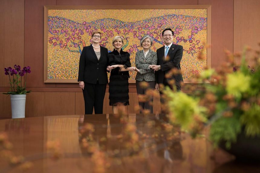 Australia's defence minister Marise Payne and foreign minister Julie Bishop stand with South Korea's foreign minister Kang Kyung Wha and defense minister Song Young Moo prior to their meeting at the Ministry of Foreign Affairs in Seoul.