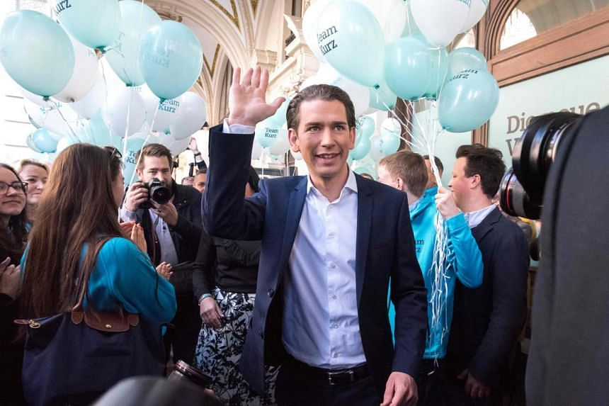 Austrian Minister for Foreign Affairs and the chairman of Austria's People's Party (OeVP), Sebastian Kurz greets his supporters as he is leaving for his 36 hours rally tour in Vienna Austria on Oct 13, 2017.