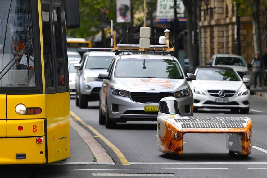 The Nuon Solar team's car named Nuna 9 drives along a main street as it approaches the 2017 World Solar Challenge finish line in Adelaide, Australia, on Oct 12, 2017.