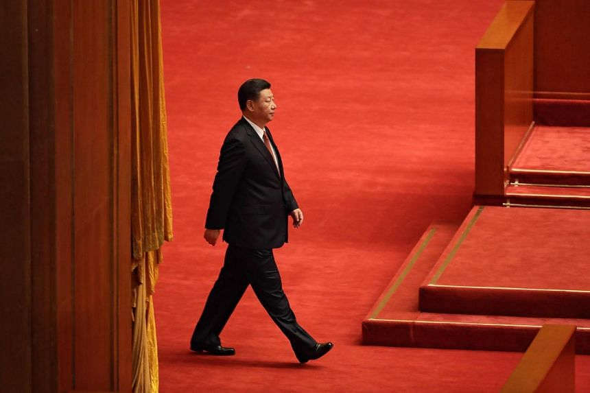 China's President Xi Jinping arriving at a ceremony to commemorate the 90th anniversary of the founding of the People's Liberation Army, at the Great Hall of the People in Beijing.