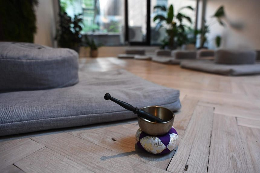 A bell sits on the floor of Mndfl mediation studio in New York.