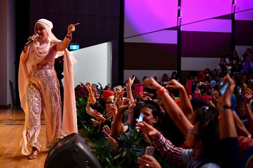 Rani Naeli, a singer from Indonesia, performing at the 8th Foreign Domestic Worker Day on Oct 15, 2017.