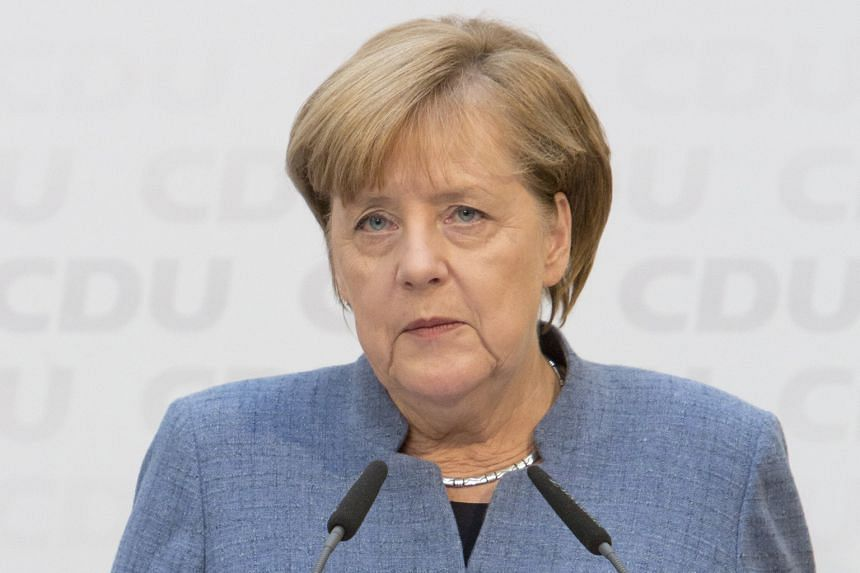 """(From left) French President Emmanuel Macron, British Prime Minister Theresa May and German Chancellor Angela Merkel said in a rare joint statement that they """"stand committed"""" to the Iran nuclear deal and that preserving it was """"in our shared nationa"""