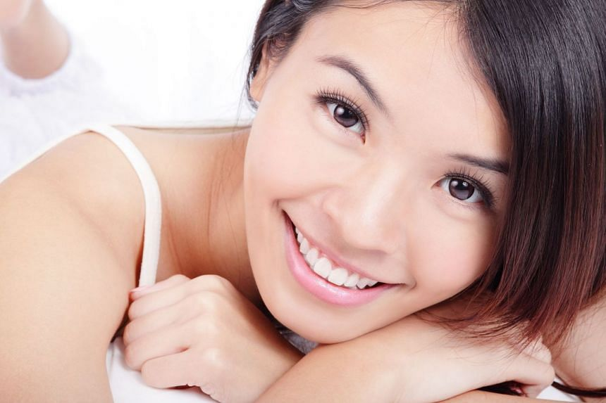 Brighten your smile with Raffles Dental's teeth whitening treatment.