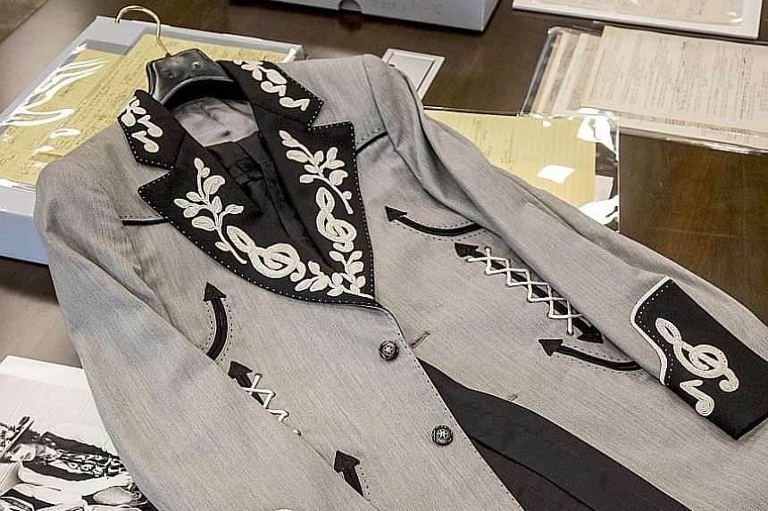 The archive includes a stage outfit (above) custom-designed for Bob Dylan as well as photographs (right) taken throughout the musician's career.