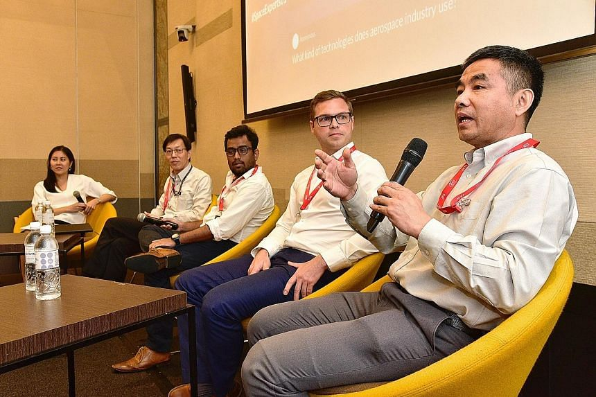 Ms Lynette Tan, executive director of the Singapore Space and Technology Association, who was the moderator at the Space Industry Awareness Talk, with the panellists, (from left) Mr Tan Khai Pang from Addvalue Technologies, Mr Rohit Jha from Transcel