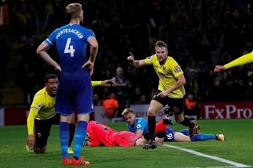 Watford's Tom Cleverley (centre) wheeling away in delight after his extra-time winner condemned Arsenal to their third loss of the campaign. The Gunners have registered only one league point on their travels so far this term.