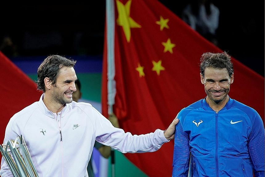 Roger Federer sharing a laugh with Rafael Nadal after the Shanghai Masters final. He can still end the season as the world No. 1.