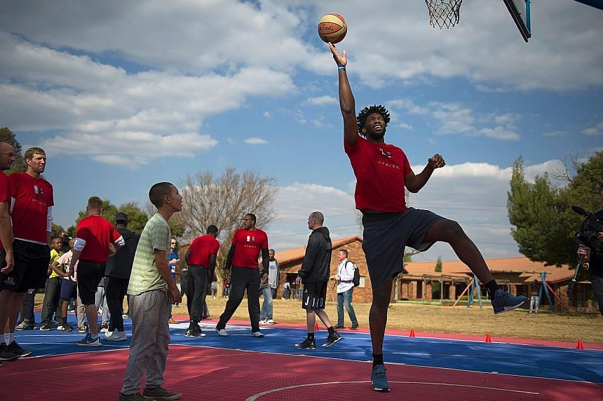 Philadelphia 76ers centre Joel Embiid demonstrating a lay-up to children during a basketball practice clinic before the NBA Africa Game 2017 in August. The injury-prone Cameroonian, who recently signed a new five-year deal extension, has played only