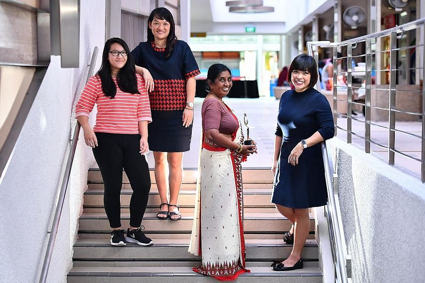 The Foreign Domestic Worker of the Year award went to Ms Jayawardena Mudiyanselage Sittamma Jayawardena, seen here with members of the Chua family: (from left) student Ho Hui Min, 16; her mother Irene Chua, 47, a teacher; and Ms Corinne Chua, 42, a l