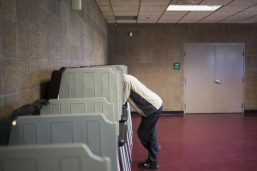 A voter casting his ballot in the US presidential race in Denver, Colorado, last year. The state will now verify election results via an advanced statistical procedure called a risk-limiting audit.
