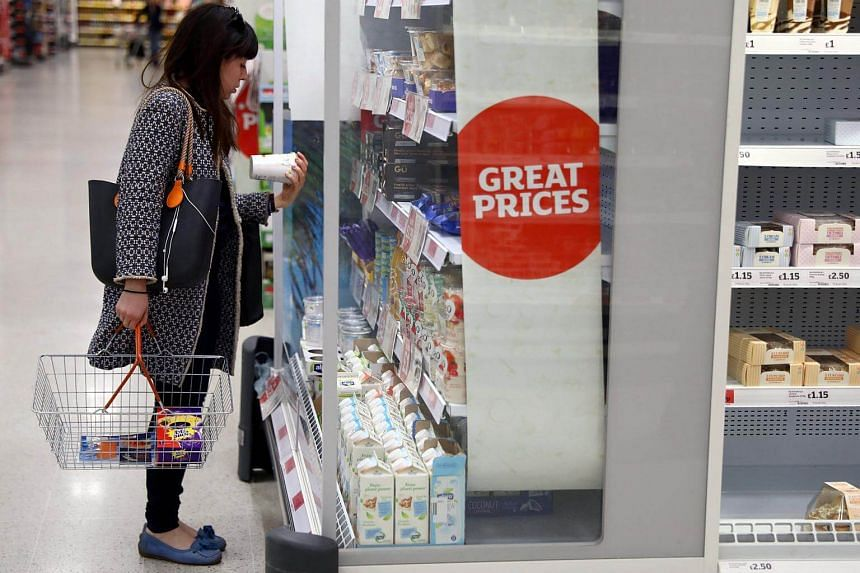 A woman shops in a supermarket in London, Britain. The NHS has already taken action that campaigners hope to see in the government's anti-obesity strategy for the whole country.