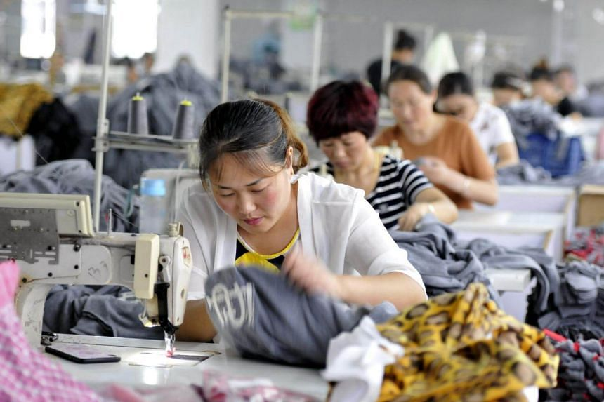 Employees working in a textile factory in Linyi in China's eastern Shandong province. Core CPI increased to 2.3 per cent, the fastest pace since 2011.
