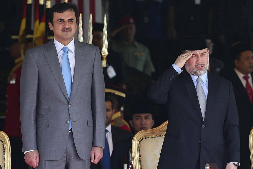 Qatar's Emir Sheikh Tamim bin Hamad al-Thani (left) and Yang di-Pertuan Agong Sultan Muhammad V inspecting the honour guard during a welcoming ceremony in Kuala Lumpur, on Oct 16, 2017.