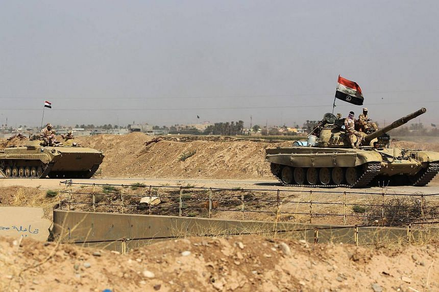 """Iraqi forces took control of """"vast areas"""" in the oil-rich region of Kirkuk without opposition from Kurdish Peshmerga, state TV said on Monday (Oct 16)."""