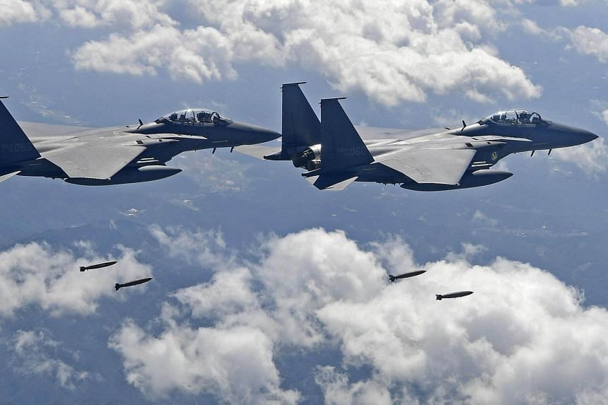 South Korean F-15K fighter jets dropping bombs at a shooting range in Gangwon Province, east of Seoul, during a joint military drill aimed to counter North Korea's latest nuclear and missile tests, on Sept 18, 2017.