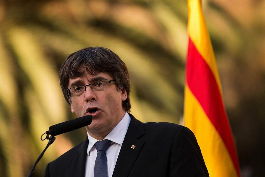 Catalan president Carles Puigdemont delivers a speech on the sidelines of a wreath-laying ceremony commemorating the 77th anniversary of the death of Catalan leader Lluis Companys at the Montjuic Cemetery in Barcelona on Oct 15, 2017.