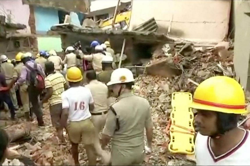 Rescue workers are seen following a building collapse in Bangalore, India on Oct 16, 2017.