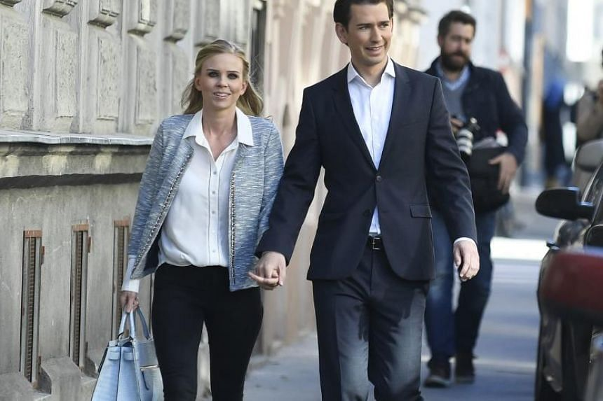 Austria's Foreign Minister and leader of Austria's centre-right People's Party (OeVP) Sebastian Kurz and his partner, Susanne Thier, arrive at a polling station to cast their votes during general elections in Vienna, Austria, on Oct 15, 2017.
