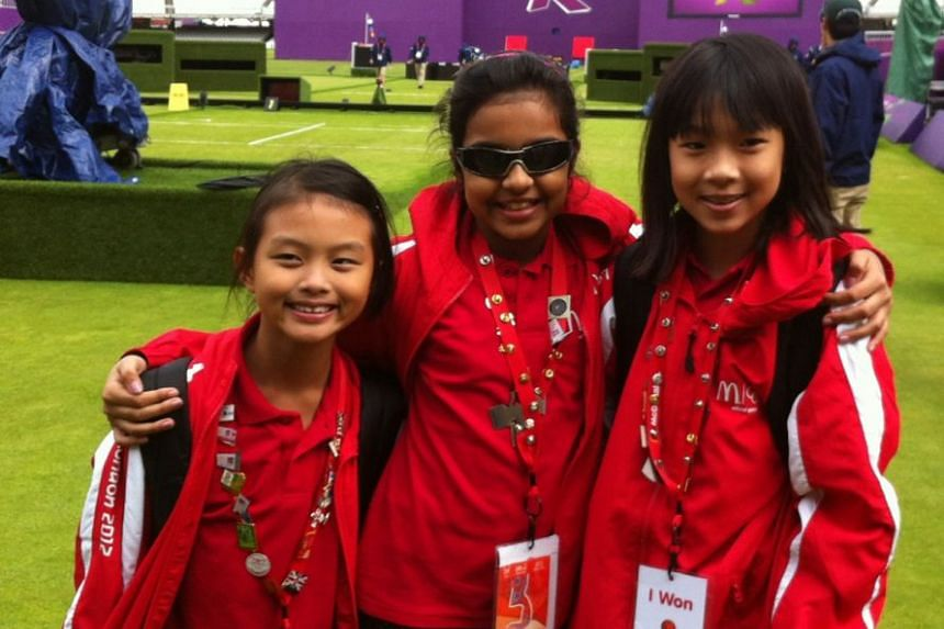 """From left: Clare Cheng, Sneha Sivakumar and Ywen Lau were selected from some 200 hopeful applicants to attend the London 2012 Olympic Games as McDonald's Champions of Play """"Young Journalists""""."""