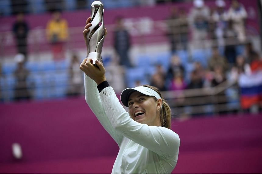 Maria Sharapova of Russia holds her trophy after winning her women's singles final match against Aryna Sabalenka of Belarus at the Tianjin Open tennis tournament in Tianjin on Oct 15, 2017.