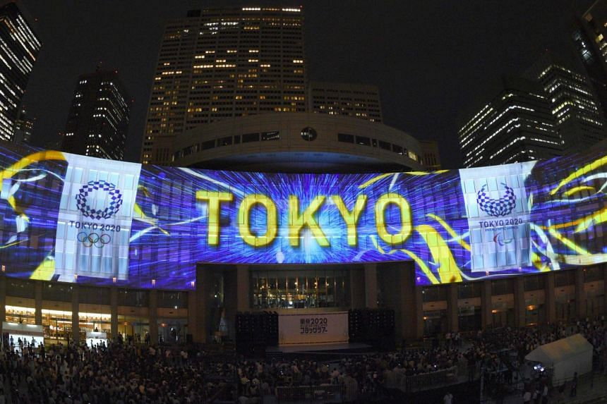 A projection at the Tokyo Metropolitan Assembly Building shows three years to go before the start of the Tokyo 2020 Olympic games.