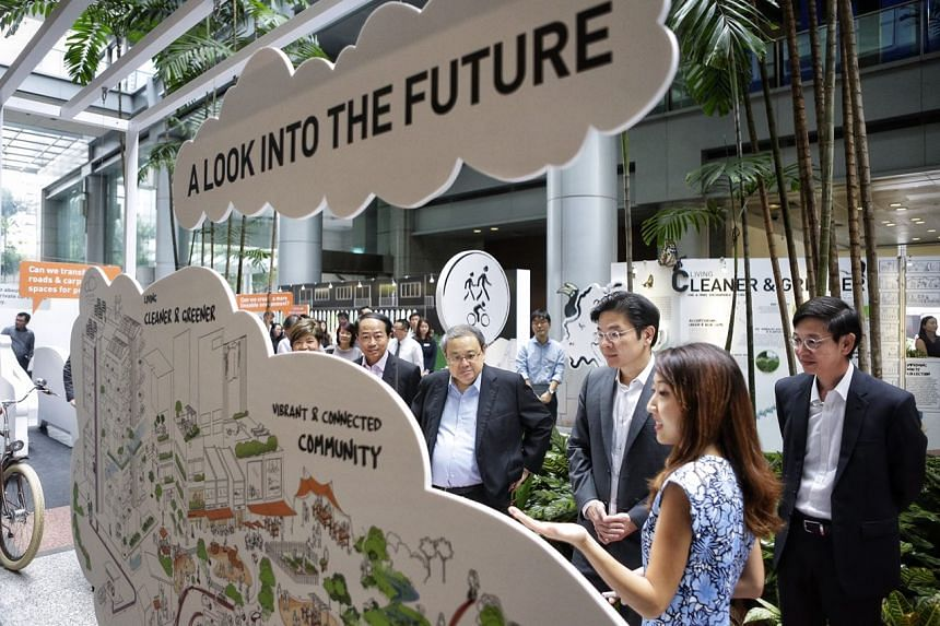 Minister for National Development Lawrence Wong touring the Our Neighbourhoods: A Look into the Future exhibition at URA Centre on Oct 16, 2017.