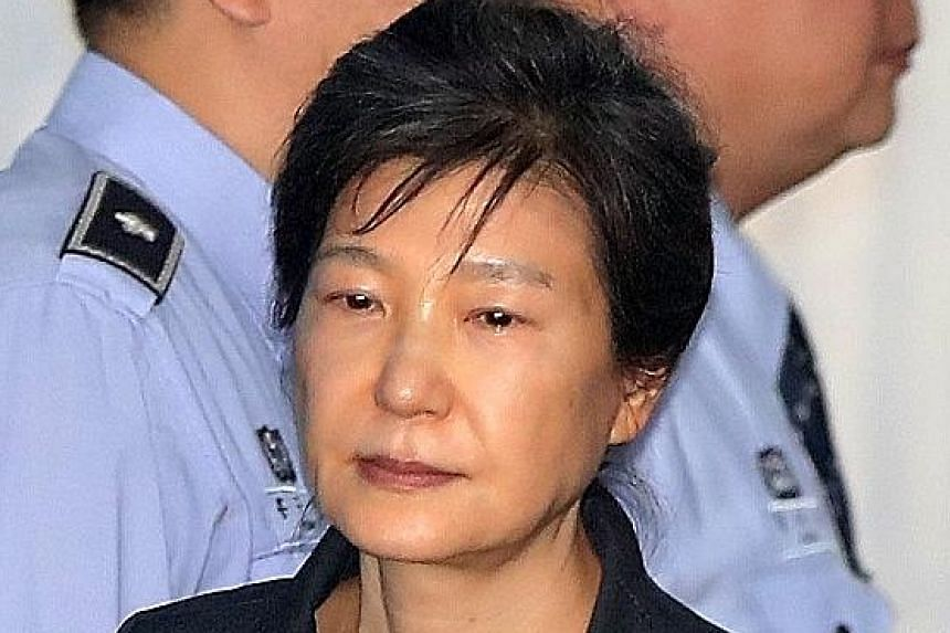 """Park Geun Hye said she hoped she would be the last victim of """"political revenge in the name of the rule of law""""."""