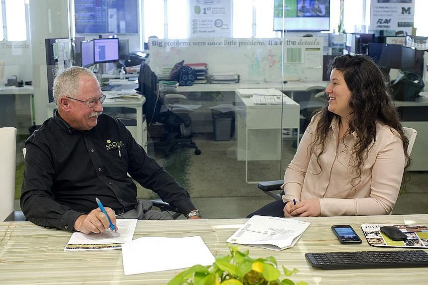Sachse Construction's Mr Jim Jehle, 66, a senior project manager, with his mentor, Ms Nicole Mancino, 27, director of marketing, at their office in Detroit.