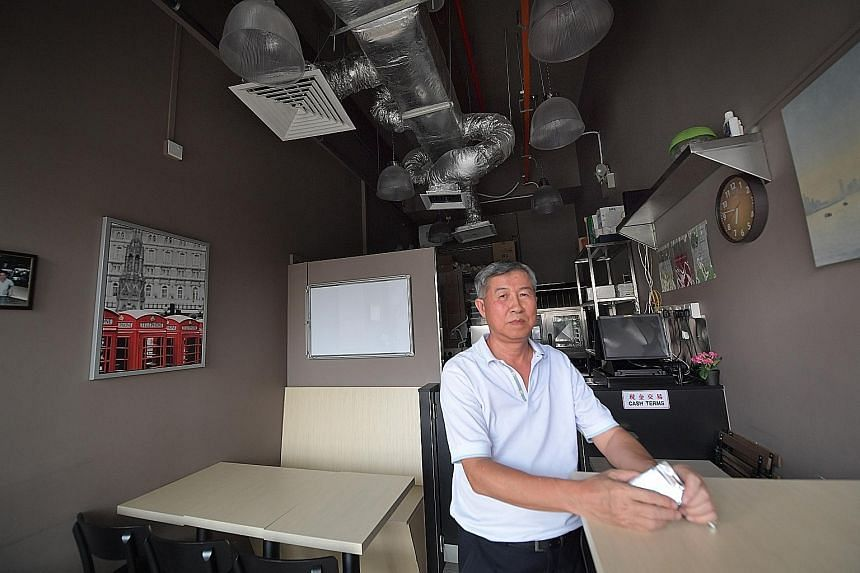 Businessman Chua G.S. is upset that the restaurant space he bought did not have an exhaust system, and he - and other unit owners - have had to fork out money to put one in.