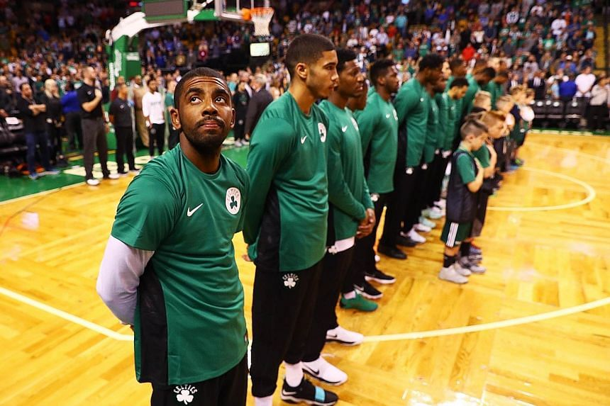 Kyrie Irving (extreme left) of the Boston Celtics initiated the trade request to leave the Cleveland Cavaliers and is now the centre of attention before the season-opener against his old team.
