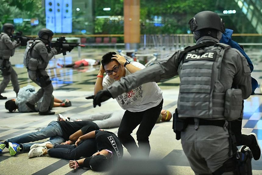 """Changi Airport came under a """"terror attack"""" early this morning - and multiple agencies dealt successfully with the threat - all as part of Exercise Northstar. In this photo taken during a media preview last week, police officers can be seen directing"""
