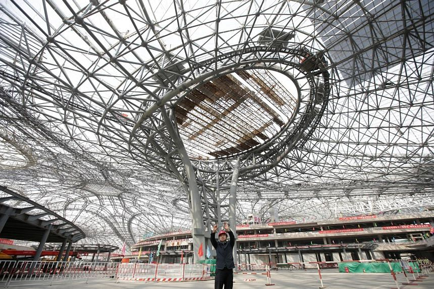 The terminal hall of the new airport, which is slated to open in October 2019. It is expected to serve an initial 45 million passengers a year with an eventual capacity of 100 million. The facility is located 67km south of Beijing, and is linked to t