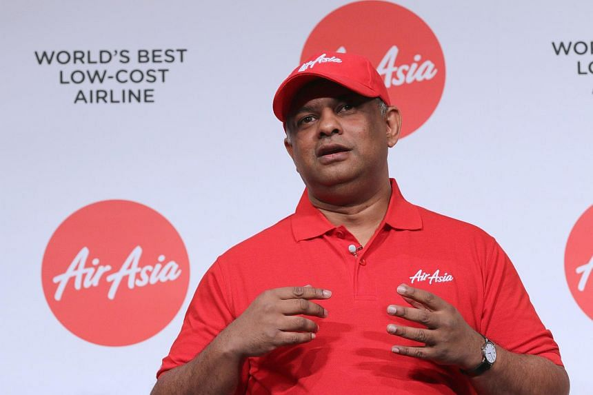 """Tony Fernandes refuted reports that a technical problem had caused the aircraft to plunge from 32,000 feet to 10,000 feet without warning, and flight attendants were said to have """"spooked passengers"""" with their behaviour."""