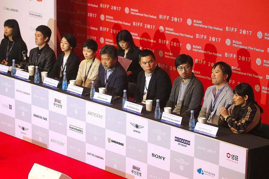 Taiwanese director Rina B. Tsou (right) speaking at a press conference for the official launch of the Ten Years international project during the 22nd Busan International Film Festival in Busan.