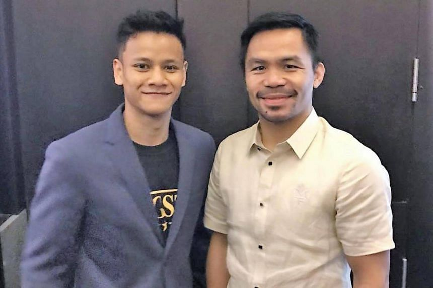 Local professional boxer Muhamad Ridhwan (left) got to meet Filipino boxing legend Manny Pacquiao over lunch, courtesy of billionaire Peter Lim.
