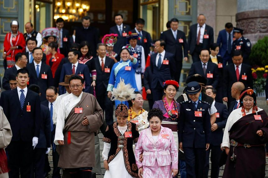 Delegates leave the Great Hall of the People in Beijing, one day before the start of 19th National Congress of the Communist Party of China, on Oct 17, 2017.