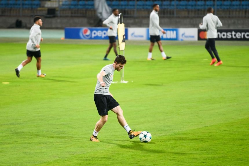 Liverpool's Scottish defender Andrew Robertson (centre) at a training session on the eve of the Uefa Champions League Group E football match between NK Maribor and Liverpool, on Oct 16, 2017.