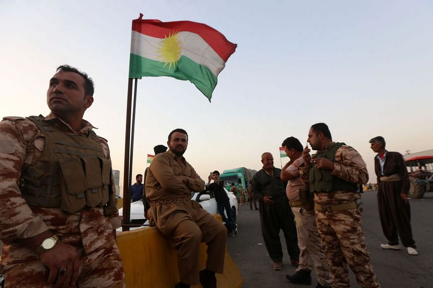 Members of the Iraqi Kurdish security forces stand guard at a checkpoint in Altun Kupri, 40km south of Arbil, the capital of the autonomous Kurdish region of northern Iraq, on Oct 16, 2017.