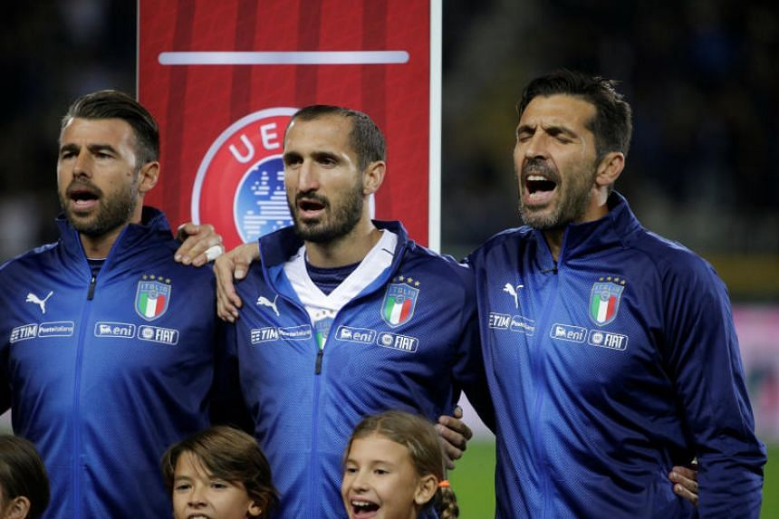 Italy's Andrea Barzagli, Giorgio Chiellini and Gianluigi Buffon singing during the national anthem before their World Cup qualifier against Macedonia in Turin, Italy on Oct 6, 2017.