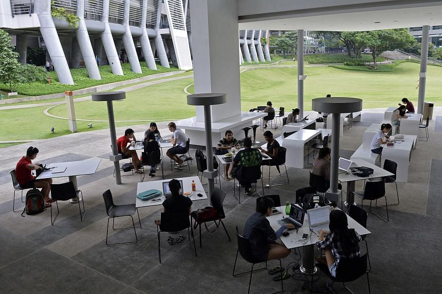 Students studying at the National University of Singapore (NUS) University Town (UTown). NUS piloted e-exams here in 2014 for about 10 per cent of its courses, and this grew to about 15 per cent in the latest academic year, which started last year.