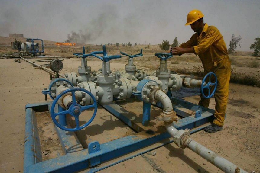 An Iraqi worker checking the valves at the Kirkuk oil field on June 29, 2009. Iraqi Kurdistan briefly shut down some 350,000 barrels per day (bpd) of production from the major Bai Hassan and Avana oilfields due to security concerns.