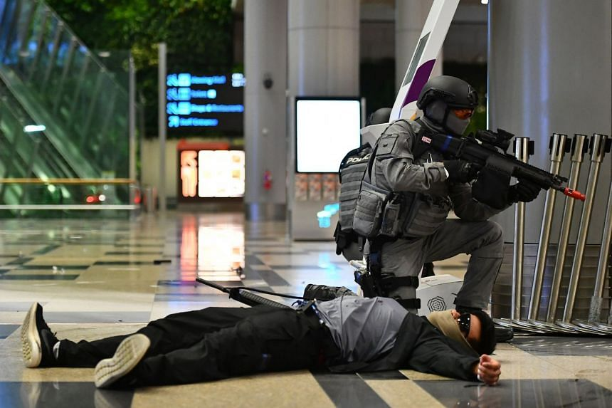 A police specialist officer securing the area after the threat is neutralised at the departure hall of Terminal 3 during the drill in the wee hours of Oct 17, 2017.