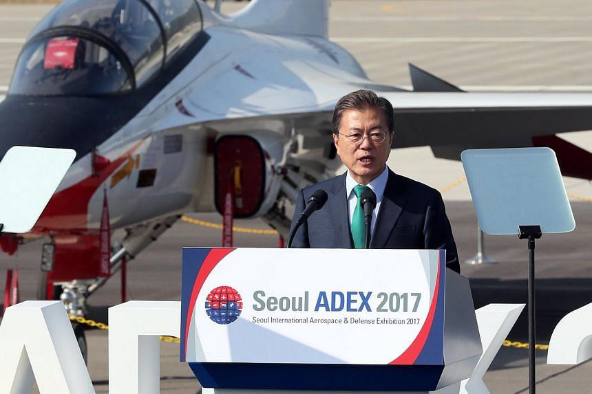 South Korean President Moon Jae In speaks during the opening ceremony of the 2017 Seoul International Aerospace and Defense Exhibition at Seoul Air Base in Seongnam, South Korea, on Oct 17, 2017.