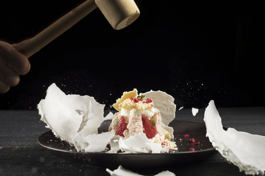 Rosella's strawberry planet, created by the chefs' sister, Rosella, is a meringue that is cracked open for an exquisite strawberry interior.